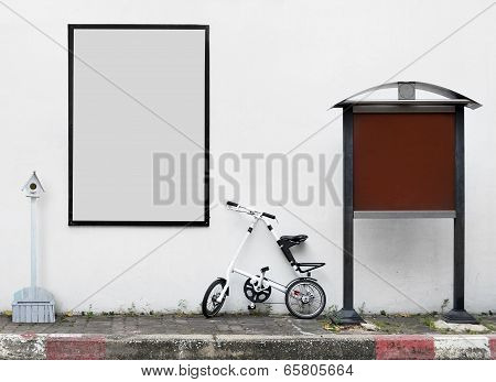 Blank Advertising Sign With Bike And Bird House