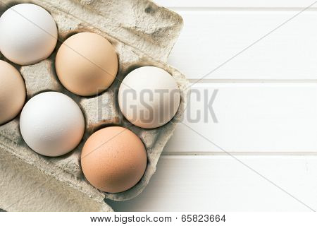 top view of chicken eggs in egg box