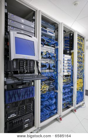 The mainframe and communication racks in data center for large organization poster