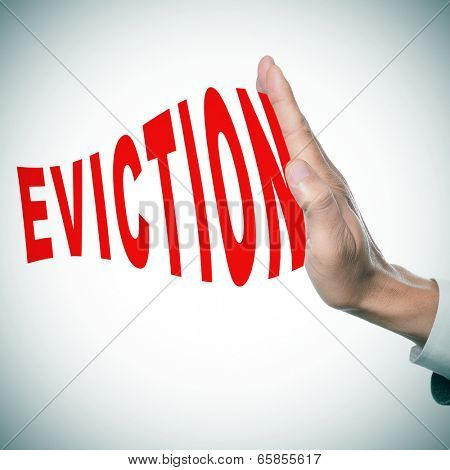 man hand stopping the word eviction
