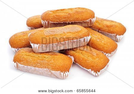 closeup of a pile of magdalenas largas, typical spanish plain muffins, on a white background