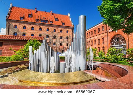 GDANSK, POLAND - 20 MAY: Polish Baltic Philharmonic in Gdansk on 20 May 2014. Neo Gothic facade of Baltic Philharmonic Hall was constructed between 1897-1898 on Olowianka island in Gdansk.