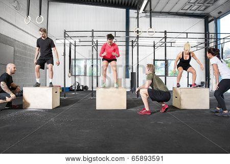 group trains box jump