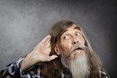 Senior man tries to listen sound. Elder hearing loss deafness. poster