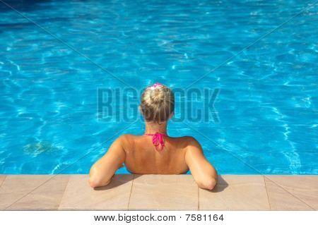 Woman at edge of pool