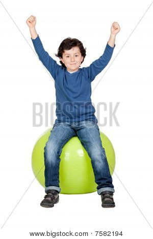 Child Sitting On A Pilates Ball