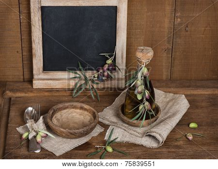 Spoon,fork And Olives And Olive Oil, Menu Black Blackboard On Table