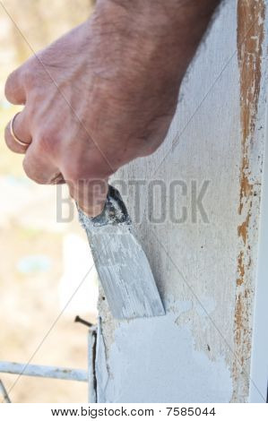 Puttying Of A Wall By A Hand With Spatula , Repair Work