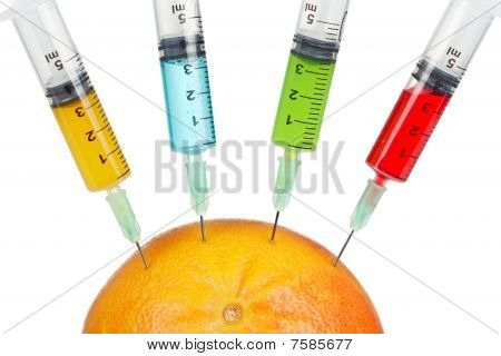 Grapefruit With Four Syringes