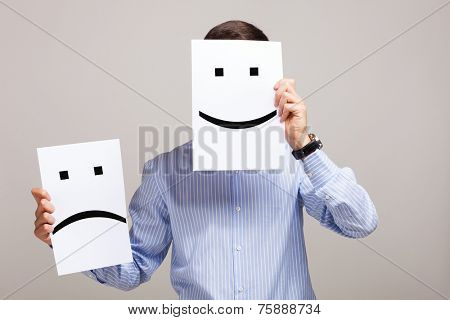 Conceptual image of a man changing his mood from bad to good