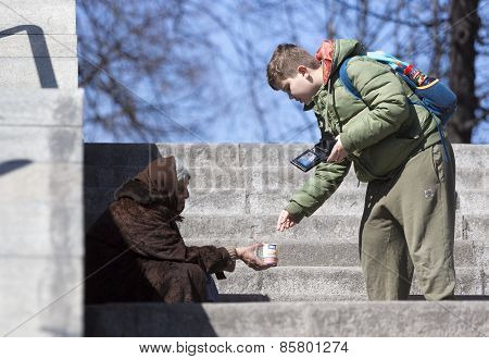 Homeless Begger Giving Money