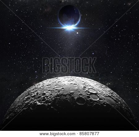 moon surface with view sunrise of the earth