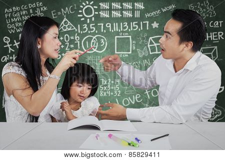 Little Girl With Two Parents Quarreling