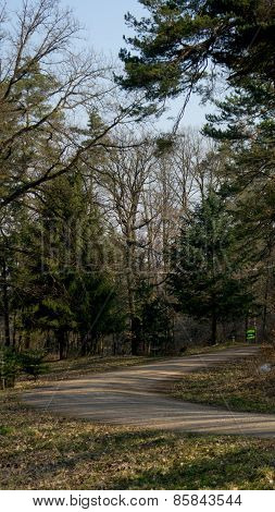 The turn on a gravel road in the woods
