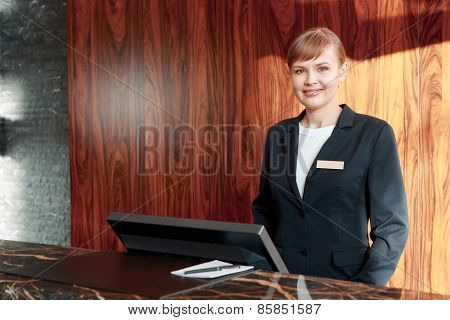 Charming receptionist at work
