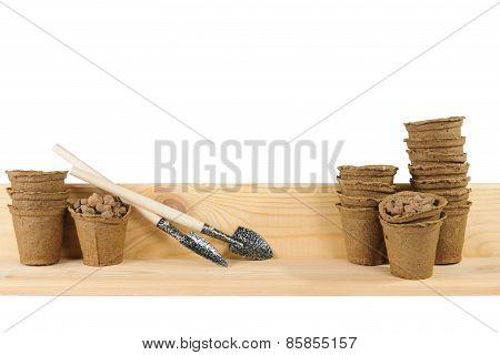 Little Garden Shovels Alongside Peat Pots