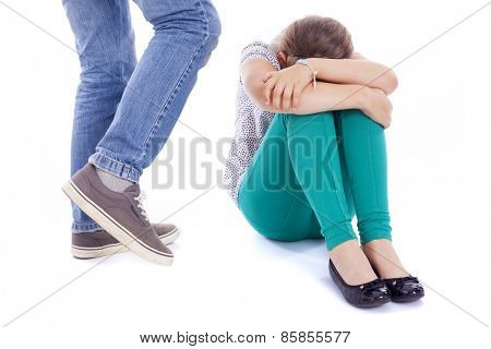 Little girl being kicked by a boy, isolated on white background