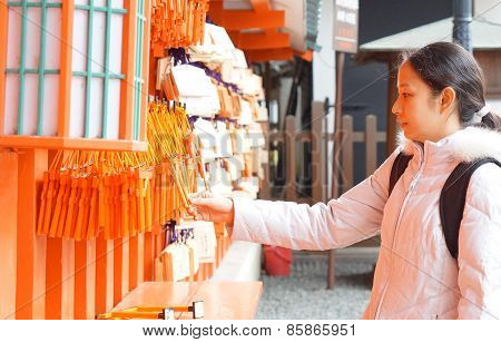 Girl With Ema In Japanese Shrine