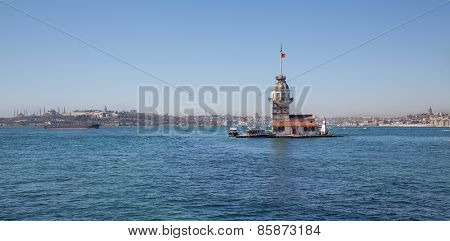 Daylight view of Maiden's Tower with boats in Istanbul, lighthouse. poster