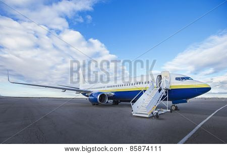 Large Airplane at the airport ready to board
