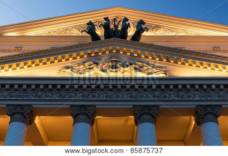 Close-up of the Bolshoi Theatre facade with night lighting in Moscow Russia poster