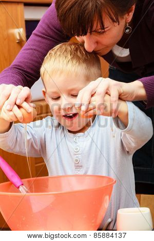 Little Boy Baking Cake With Mother, Breaking Egg.