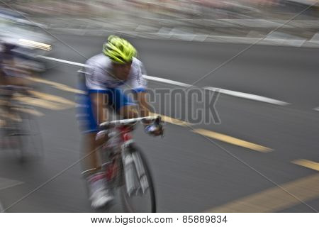 A Cyclist in motion during a competition