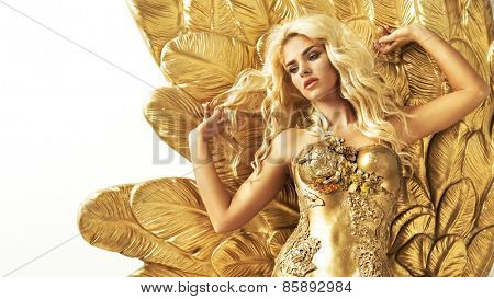 Glamorous woman in gold