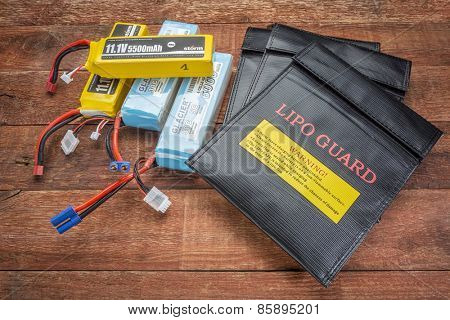 FORT COLLINS, CO, USA - March 19, 2015:  LiPo (lithium polymer) batteries used in drones and RC model with protective, fireproof, charging bags.
