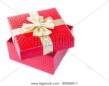 Single Red Gift Box With Gold Ribbon.