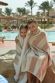Portrait of wet Brother and Sister on vacation resort ovre pool poster
