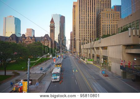TORONTO,CANADA-JULY 9,2015: Queen street in downtown toronto. Old City Hall building in the background, home to the city council from 1899 to 1966 and one of the city's most prominent structures.