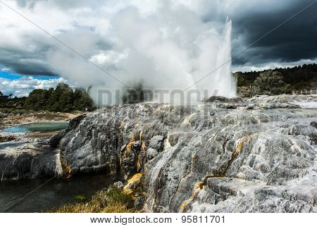 Pohutu and Prince of Wales geysers in Rotorua area, New Zealand. Dramatic sky