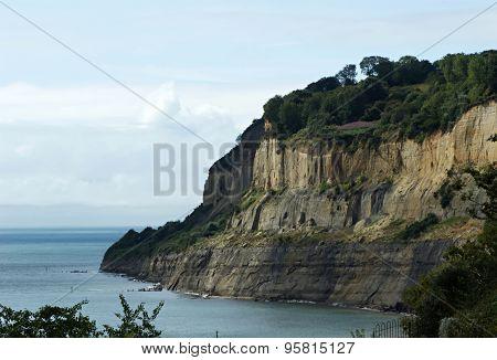 Cliff Jutting Into Sea