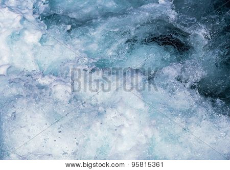 seething sea water with white foam and bubbles