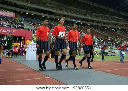 May 27, 2015 - Shah Alam, Malaysia: Match officials lead the players of Tottenham Hotspur and Malaysia out into the field in a friendly football match. Tottenham Hotspur is on a Asia-Australia tour.