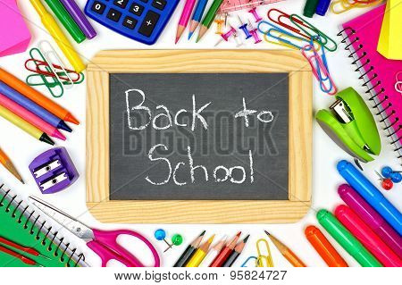 Back To School chalkboard with school supplies frame