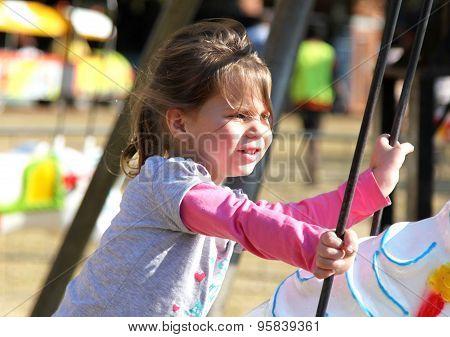 Sweet Little Girl Riding On Carousel Festival