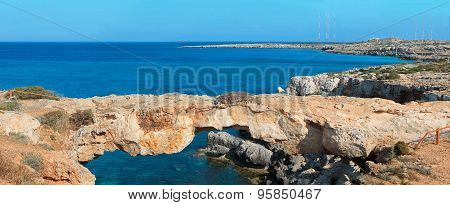 Panoramic View Of A Natural Rock Bridge At Sea Coast