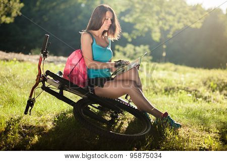 Beautiful Sport Girl With Bicycle Read A Map