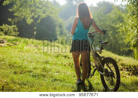 Sport Girl With Bicycle Look At Sunrise