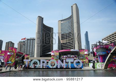 TORONTO CANADA JULY 2015: Toronto panamerican game principal site at Nathan Phillips square in Toronto, Canada with town hall in background,