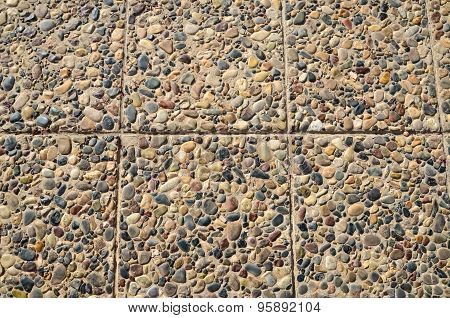 Floor Paved With Pebbles And Stone Tiles