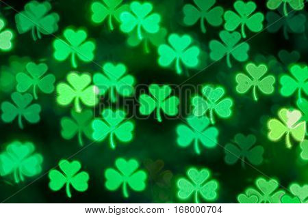 St Patricks Day green trefoil clover bokeh background - St Patricks day is Irish national holday. St Patricks day bokeh background