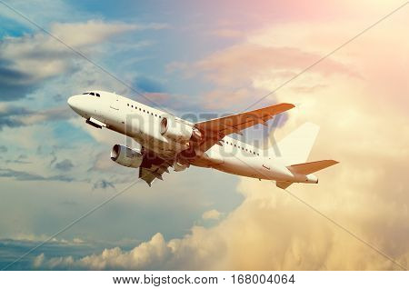 Airplane with blank livery taking off into the sky - travel background of airplane taking off.  Closeup of airplane taking off.  Commercial airplane with blank livery taking off