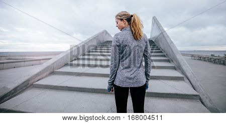 Fitness Female Standing By Steps In Morning