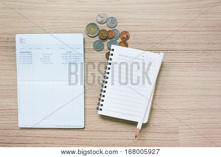 Blank Or Empty Note Book And Pencil With Book Bank Account And Coins