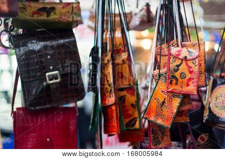 Handicraft leather bags for sale at a shop in Delhi. These are popular fashion acessories at a  budget