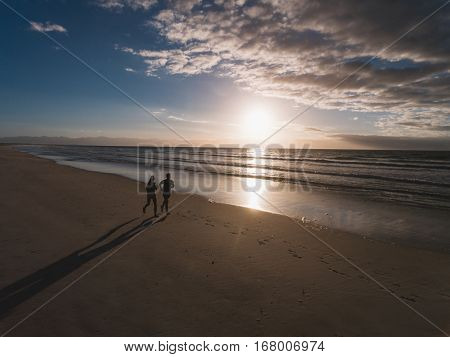 People Running On The Beach In Morning