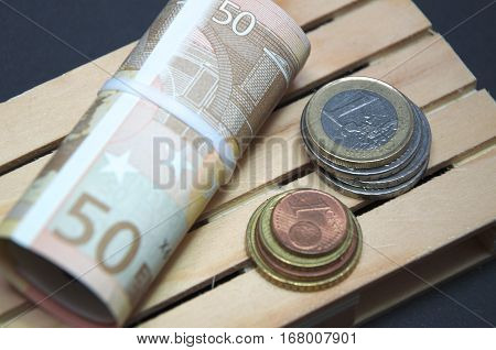 Euro banknotes and coin money on the pallet. macro photo european currency.